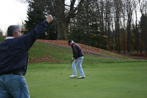 Pete Fitsik makes the winning putt for Team Wes in the inaugural Cupp Cup.  Ron Artigiani approves!