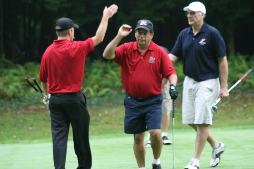 Teammates Joe Vescio and John Haberer celebrate the only victory for Team Wes in the Best Ball format.