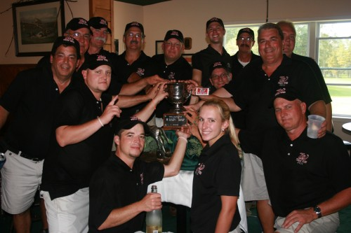 Team Wes celebrates with the Cup as Ron Artigiani uses Mark Lloyd as a drink coaster