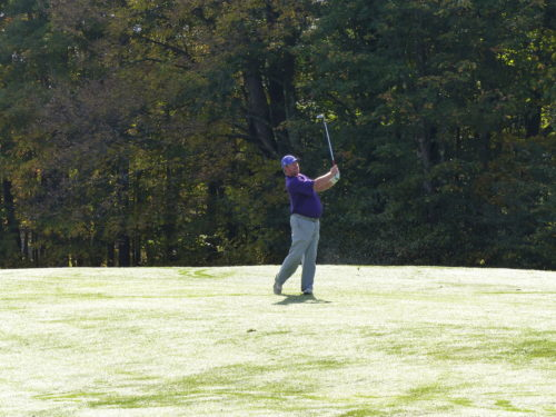 Dizzer Joe Hughes hits a wedge into the 7th green.