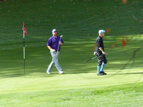 Joe Hughes and John Haberer stroll off of the 7th green.
